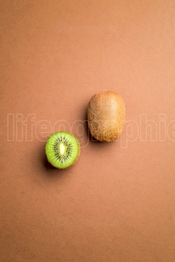 Kiwi fruit on brown background