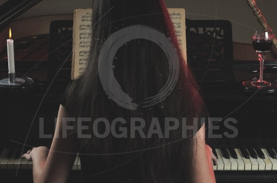 Lady with beautiful hair playing the piano