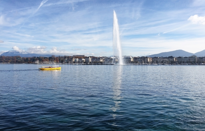 Lake Geneva Switzerland with water fountain and water taxi on a