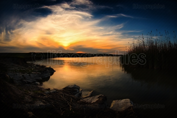 Landscape at sunset/sunrise by the lake