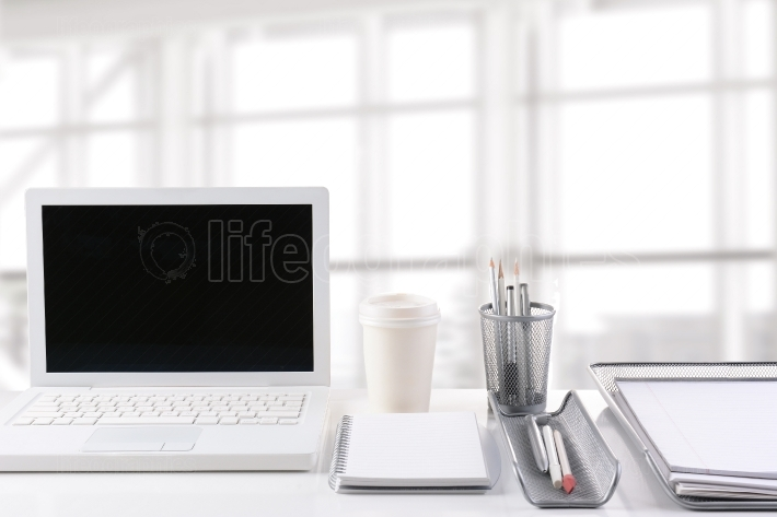 Laptop on Desk in Modern Office