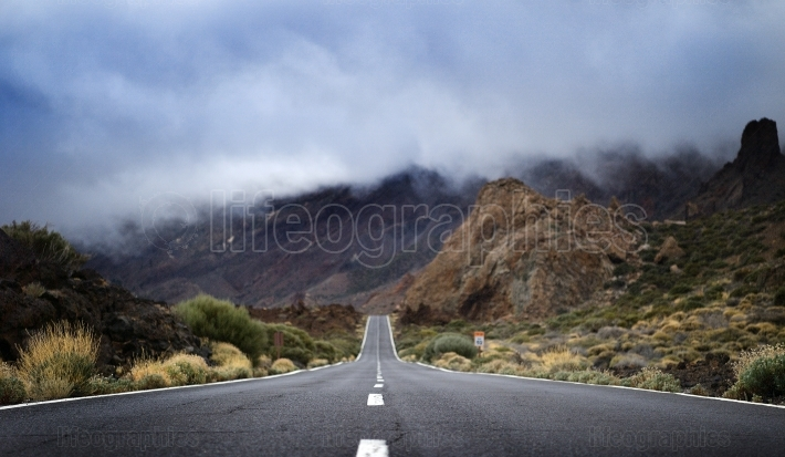 Lava rocks and road in national park El Teide on canarian island