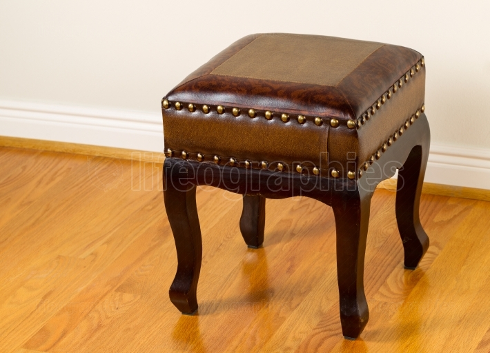 Leather footstool on traditional Oak floors