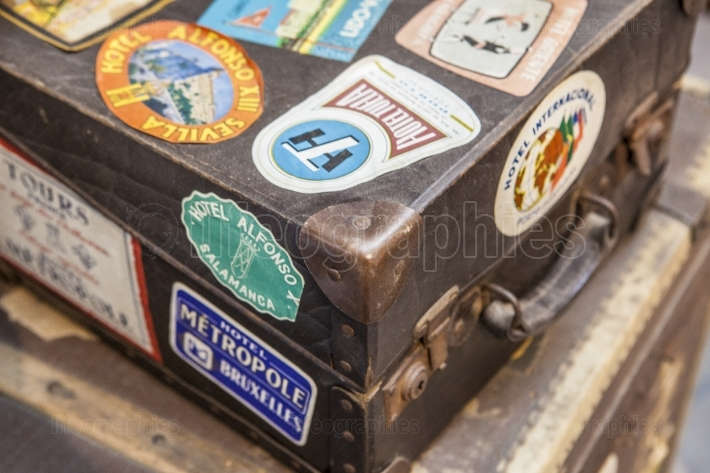Leather luggage suitcases full of hotel stickers