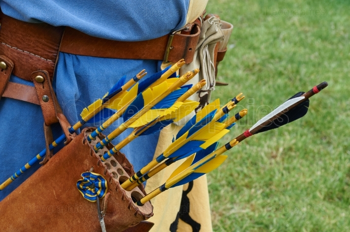 Leather quiver with  colored arrows . Detail