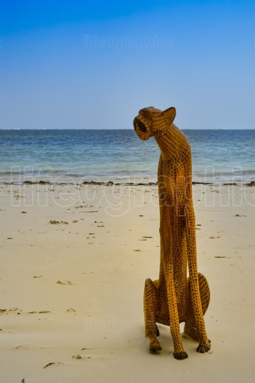 Leopard Sculpture on the sandy beach