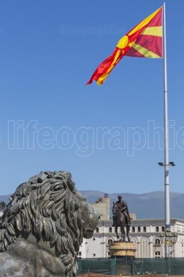 Lion statue and macedonian flag, skopje, macedonia