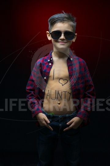 Little boy with sun glasses and I love aunty message written on him