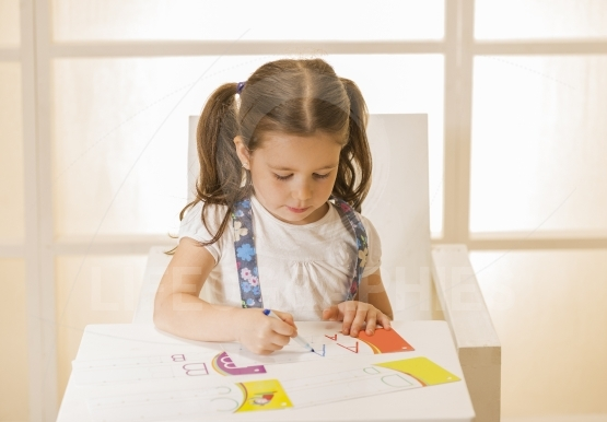 Little child writing letter A