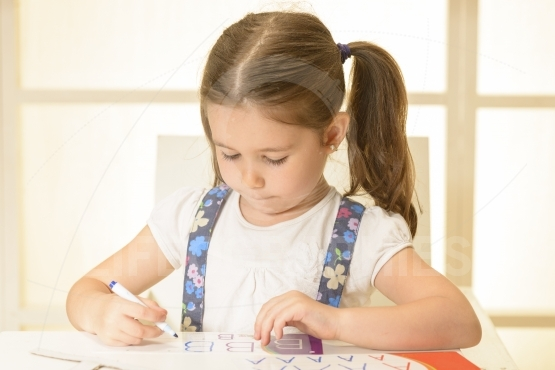 Little child writing letters