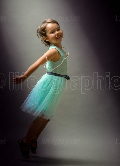 Little cute girl dancing  on black background