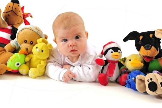 Little girl and plush toys