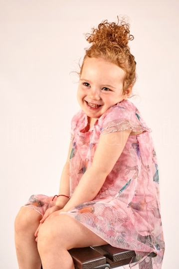 Little Girl Fashion Model in Rose Dress