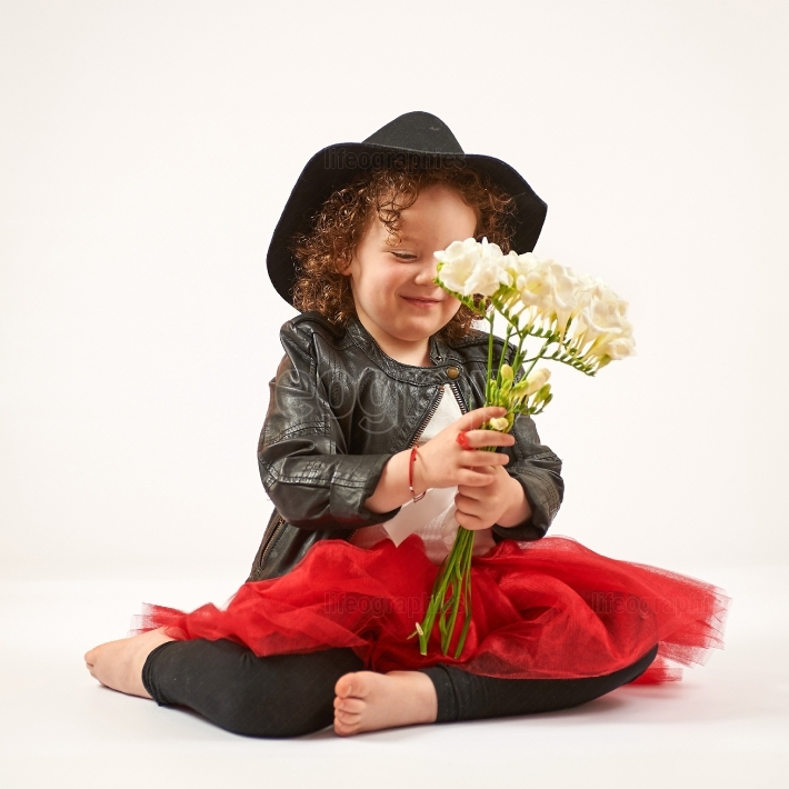 Little Girl Fashion Model With Black Hat