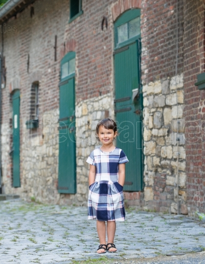 Little girl in dress posing outdoor