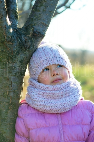 Little girl in winter season with hat  thinking at christmas