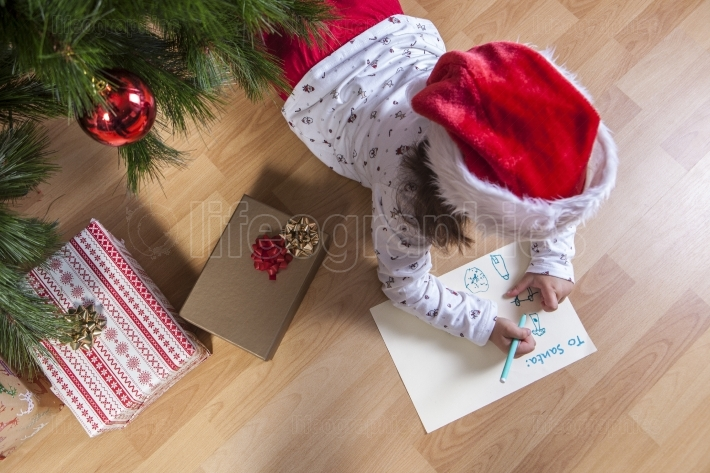 Little girl preparing The Santa Letter