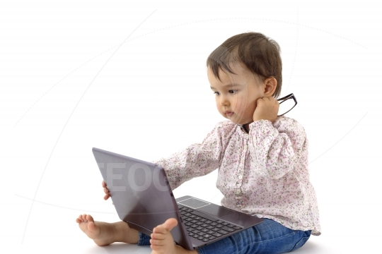 Little girl with glasses and digital tablet