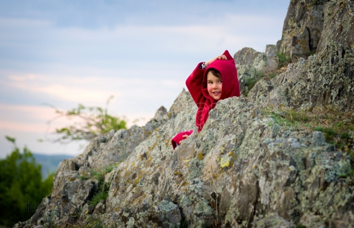Little girl with Red Riding Hood costume in the nature