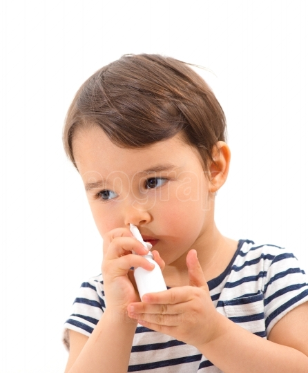 Little sick girl use medical spray for breath