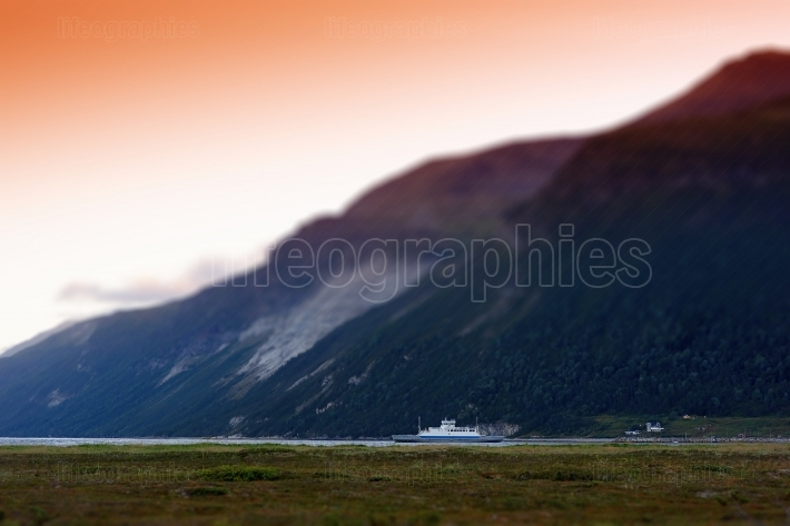Lonely Norway ship in fjords postcard background