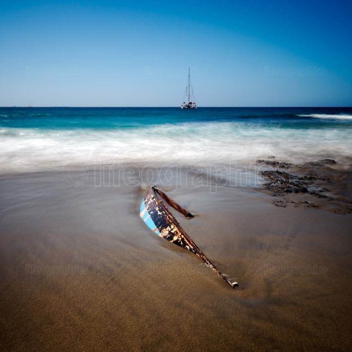 Lonely wrecked boat on the beach