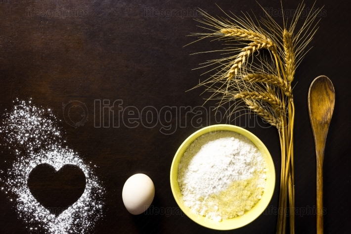 Love bread,cooking, cakes concept on wood table background