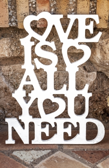 Love is all you need sing over rustic ground
