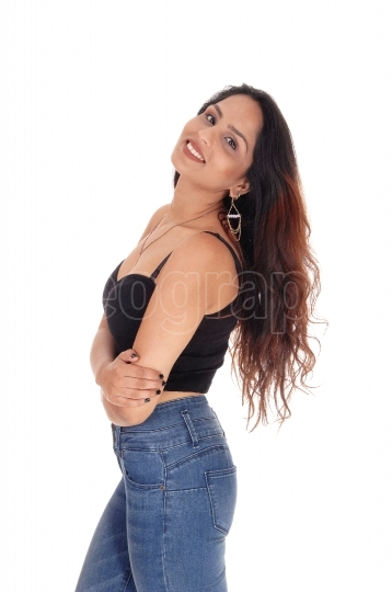 Lovely happy woman in a corset and jeans