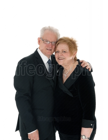 Lovely older couple embracing.