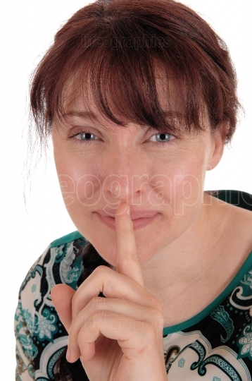 Lovely woman holding finger over mouth.