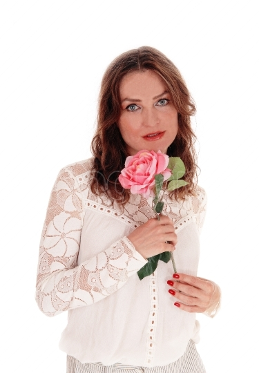 Lovely woman with pink rose