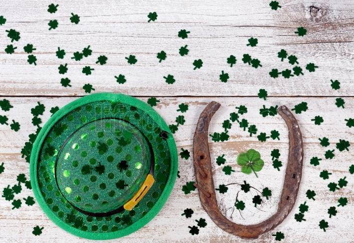 Lucky St Patrick Day with traditional items on rustic white wood