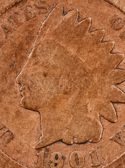 Macro view of a toned copper metal coin showing its age
