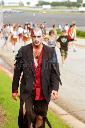 Male Zombie Rests After Chasing Humans In 5K Race