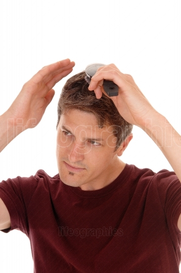Man brushing his hair.