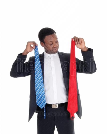 Man can not decide what necktie to wear