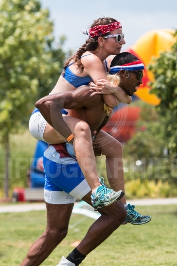 Man carries woman piggyback style at atlanta field day games