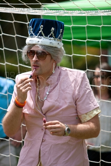 Man Dressed As Queen Elizabeth Applies Lip Gloss