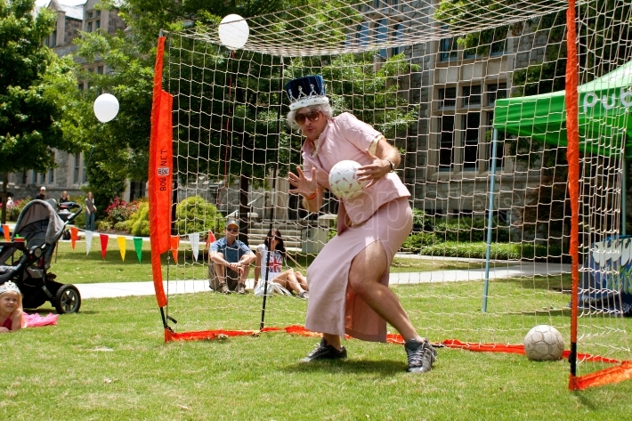 Man Dressed As Queen Elizabeth Plays Soccer Goalie