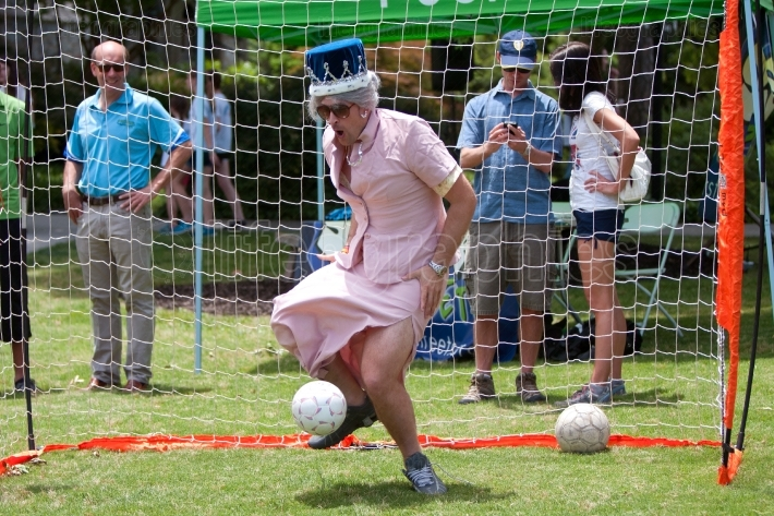 Man Dressed As Queen Elizabeth Plays Soccer Goalie At Festival
