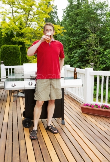 Man drinking beer on outdoor patio