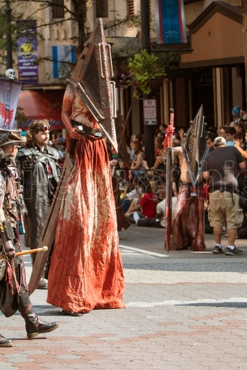 Man On Stilts Wears Bloodstained Costume In Dragon Con Parade