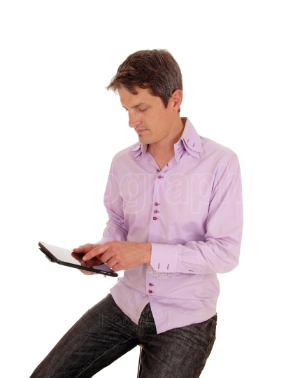 Man playing with tablet pc.