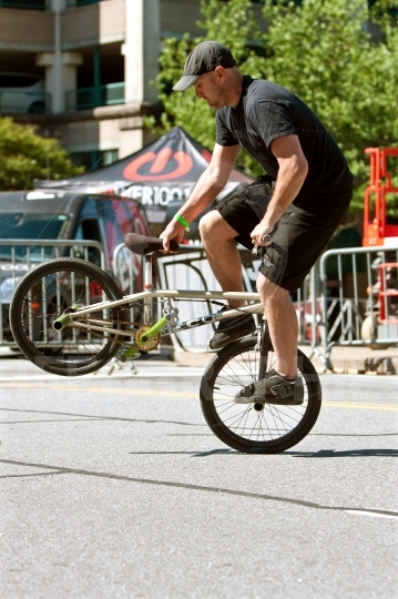Man practices riding bike backwards before bmx contest