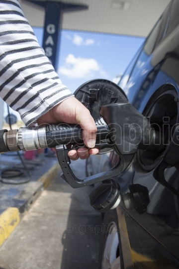 Man pumping gasoline fuel in car