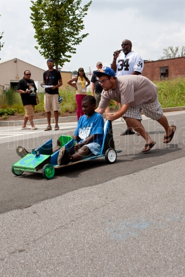 Man Pushes Kid Steering Car In Atlanta Soap Box Derby