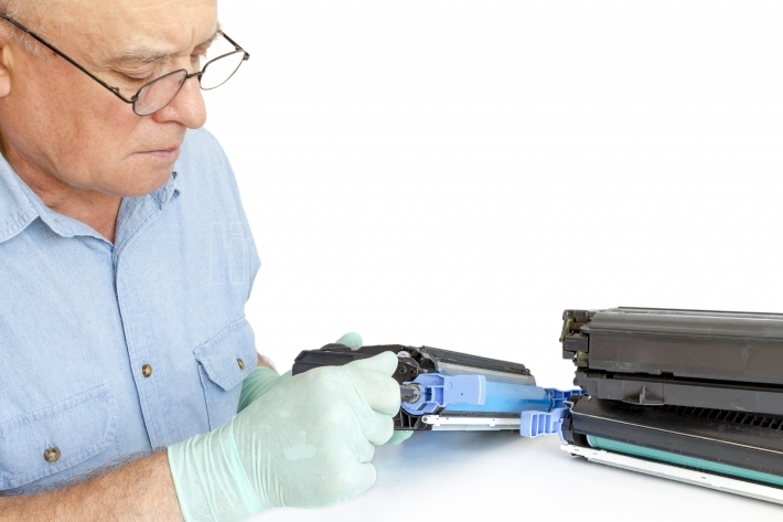 Man repairing toner cartridge