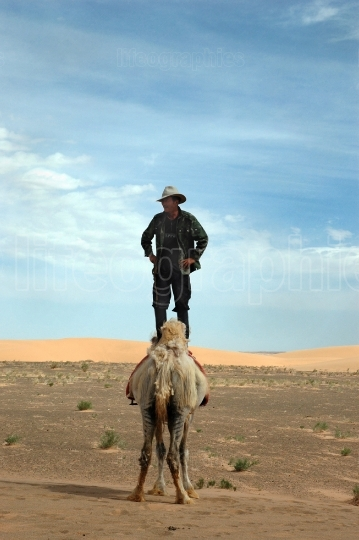 Man Standing on Camel
