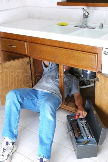 Man Under Sink with Toolbox